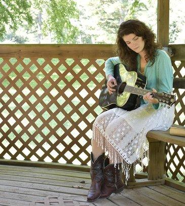 vrouwelijke gitarist